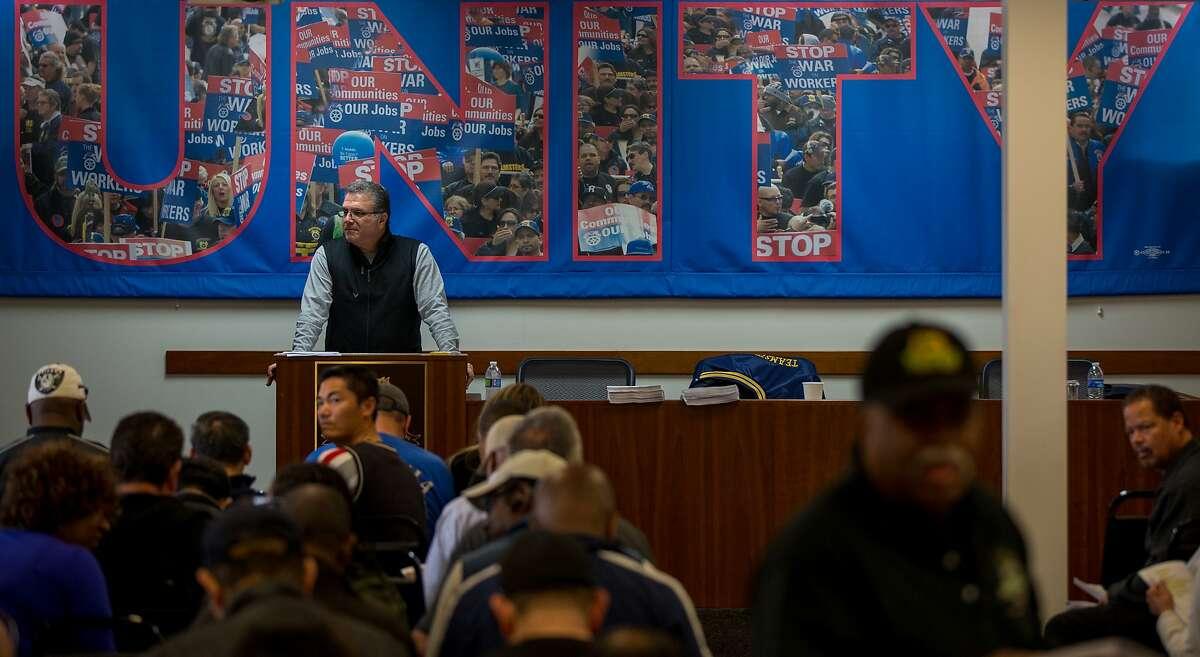 Rome Alise speaks to shuttle drivers gathered to vote on a proposed contract from Compass Transportation on Sunday, Nov. 22, 2015 in San Leandro, Calif.