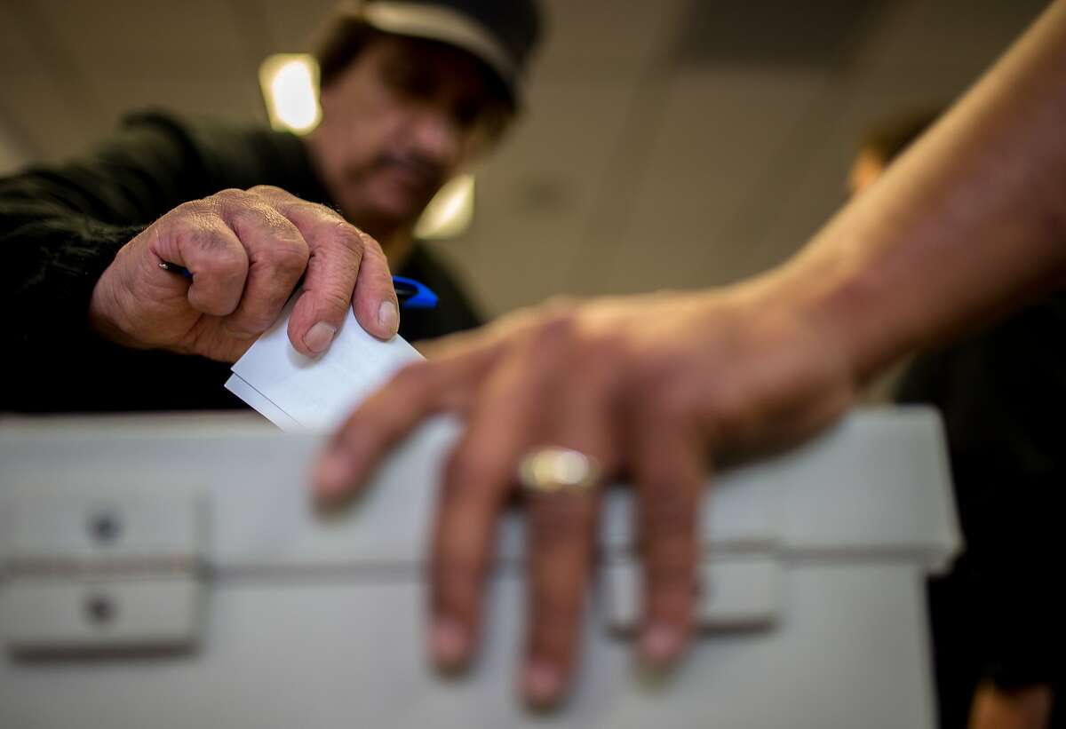 Ralph Martinez, a shuttle driver, casts his vote on a proposed contract from Compass Transportation on Sunday, Nov. 22, 2015 in San Leandro, Calif.