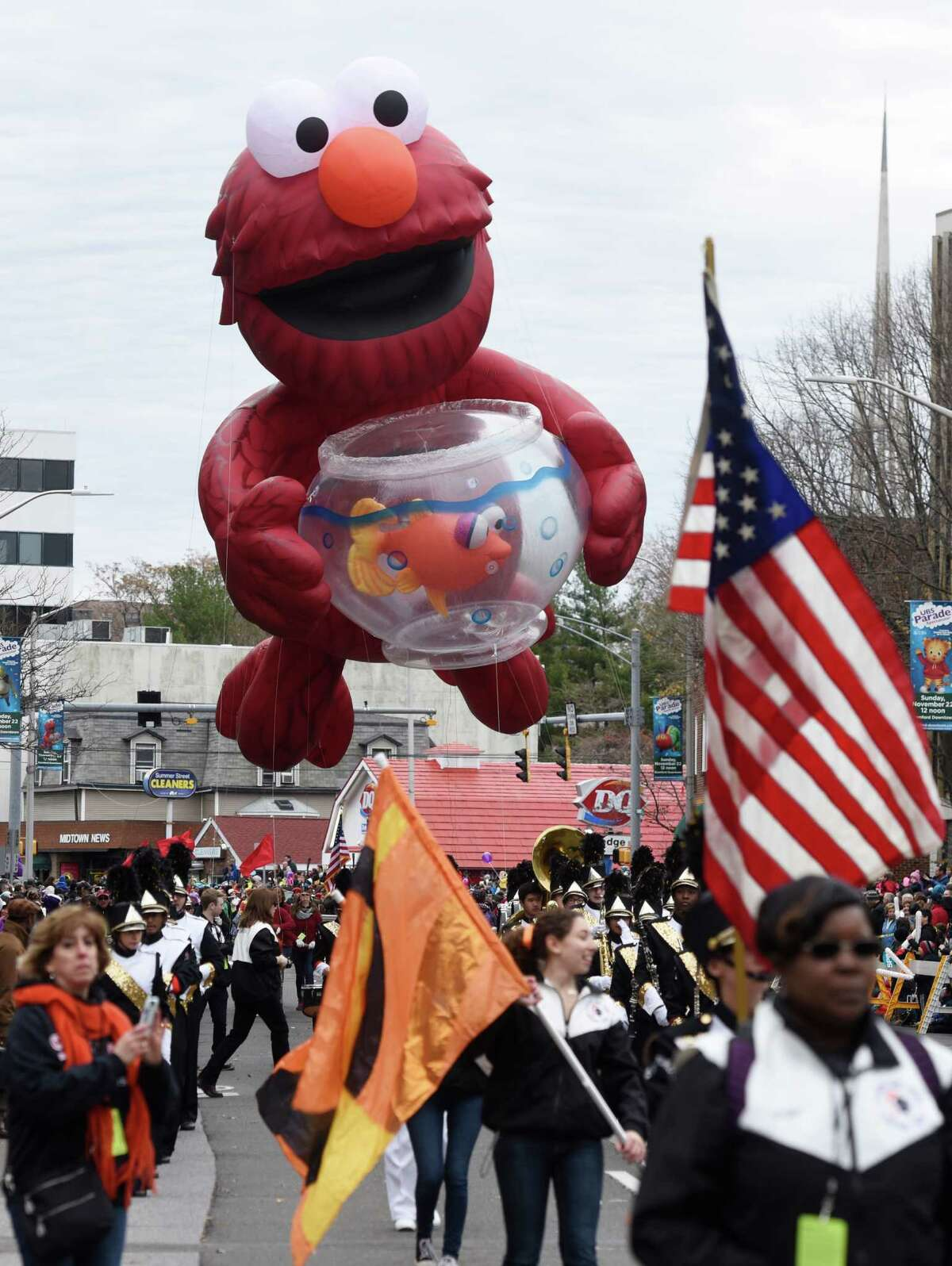 A giant helium Elmo balloon floats down the street during the UBS Parade Spectaular in downtown Stamford, Conn. Sunday, Nov. 22, 2015. The annual balloon parade, presented by Stamford Town Center and the Stamford Advocate and Hearst CT Media, featured giant helium balloon characters, award-winning marching bands and floats.