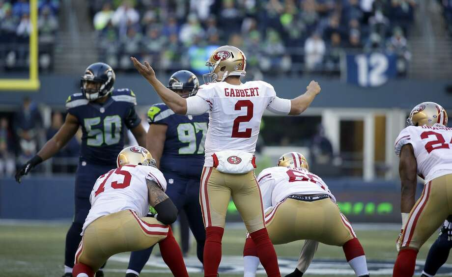 San Francisco 49ers quarterback Blaine Gabbert (2) gestures at the line of scrimmage during the first half of an NFL football game against the Seattle Seahawks, Sunday, Nov. 22, 2015, in Seattle. (AP Photo/Elaine Thompson) Photo: Elaine Thompson, Associated Press