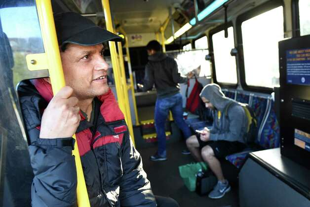 Ajaya Adhikari of Saratoga Springs, left, chats with CDTA driver Pat Caccavo during the ride to Skidmore College on Wednesday, Nov. 18, 2015, in Saratoga Springs, N.Y. (Cindy Schultz / Times Union) Photo: Cindy Schultz / 10034341A