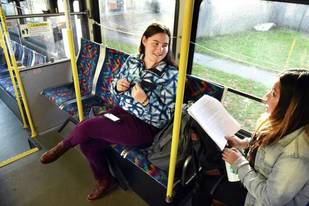 Skidmore College students Emily Cooper, 18, left, and Annie Raksasa, 18, study to be student ambassadors while they ride the bus on Wednesday, Nov. 18, 2015, in Saratoga Springs, N.Y. (Cindy Schultz / Times Union) Photo: Cindy Schultz / 10034341A