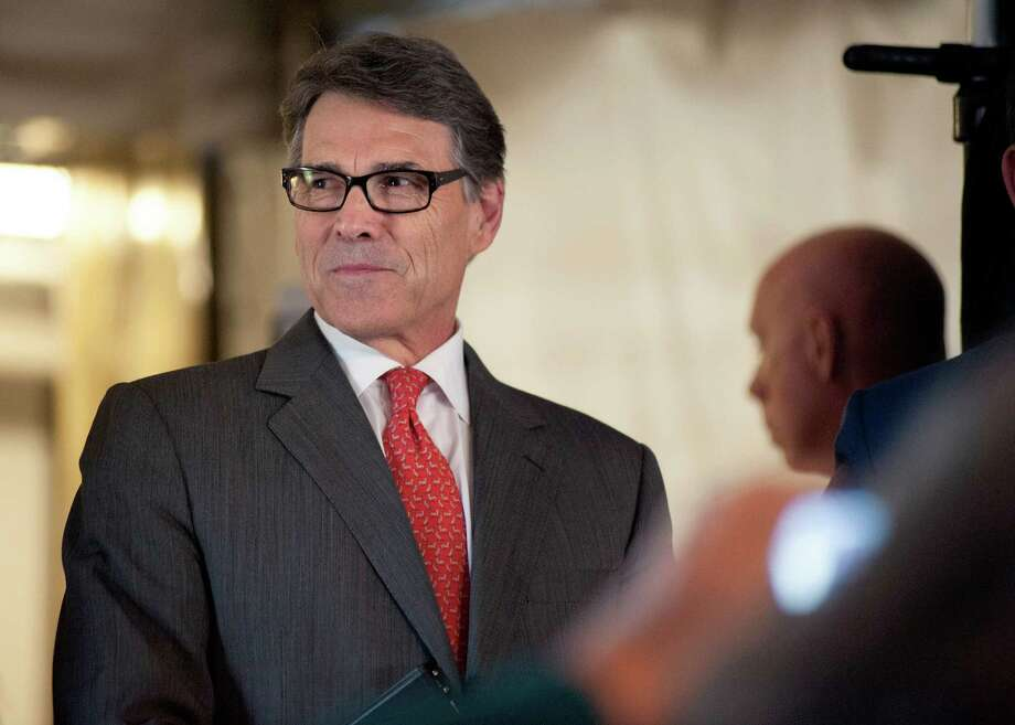 Republican presidential candidate former Texas Gov. Rick Perry prepares to speak at the Eagle Council XLIV, sponsored by the Eagle Forum in St. Louis Friday, Sept. 11, 2015.  During his speech Perry ended his second bid for the Republican presidential nomination, becoming the first major candidate of the 2016 campaign to give up on the White House.  (AP Photo/Sid Hastings) Photo: Sid Hastings, FRE / FR158536 AP