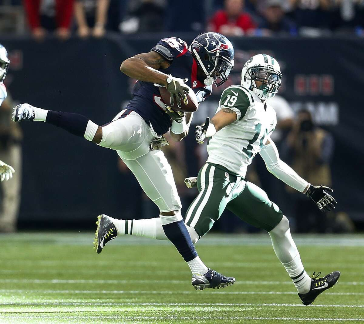 Houston Texans defensive back Eddie Pleasant (35) hauls in an interception on a pass intended for New York Jets wide receiver Devin Smith (19) during the fourth quarter of an NFL football game at NRG Stadium on Sunday, Nov. 22, 2015, in Houston. ( Karen Warren / Houston Chronicle )