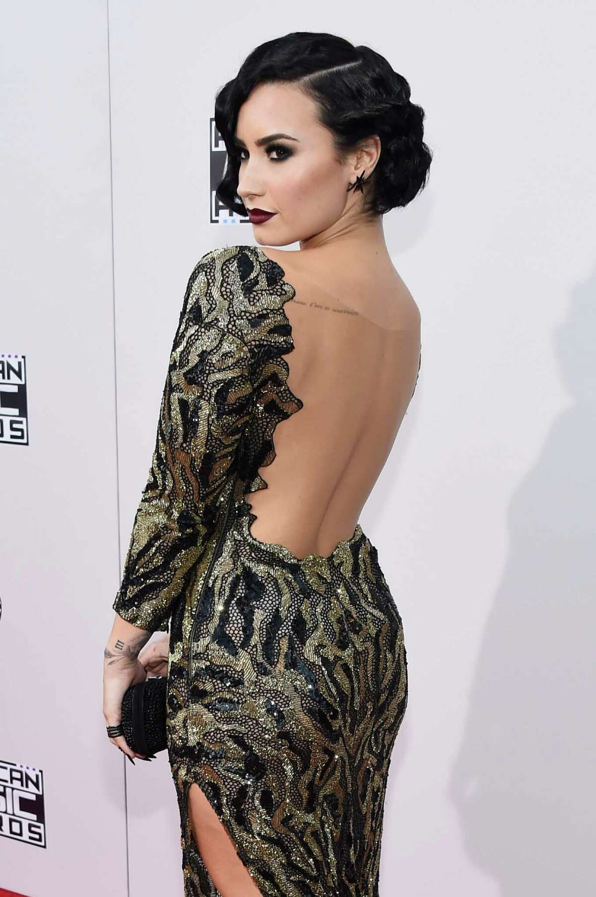 Recording artist Demi Lovato attends the 2015 American Music Awards red carpet arrivals sponsored by FIAT 500X at LA Live on November 22, 2015 in Los Angeles, California