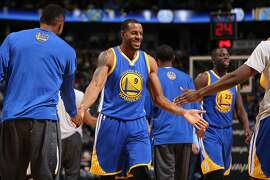 DENVER, CO - NOVEMBER 22:  Andre Iguodala #9 of the Golden State Warriors celerbates with teammate as he heads to the bench for a time out against the Denver Nuggets at Pepsi Center on November 22, 2015 in Denver, Colorado. NOTE TO USER: User expressly acknowledges and agrees that, by downloading and or using this photograph, User is consenting to the terms and conditions of the Getty Images License Agreement.  (Photo by Doug Pensinger/Getty Images)