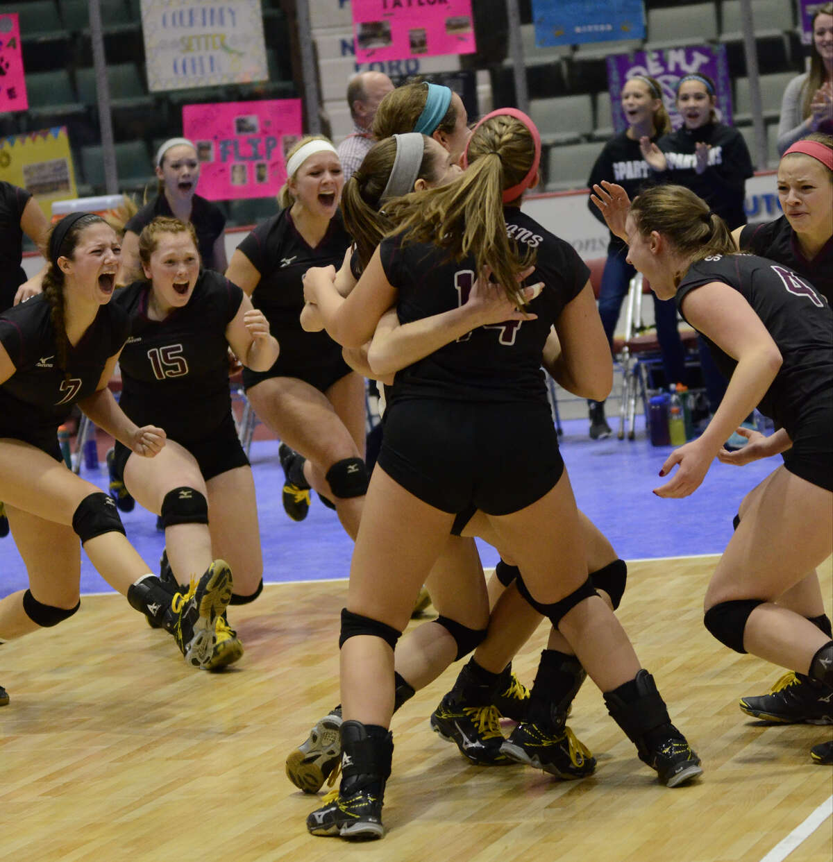 Burnt Hills-Ballston Lake volleyball players run onto the court after winning the final set in the Class A State Volleyball Championship against Walter Panas, Sunday, Nov. 22, 2015, in Glens Falls, N.Y. (Jenn March/Special to the Times Union)