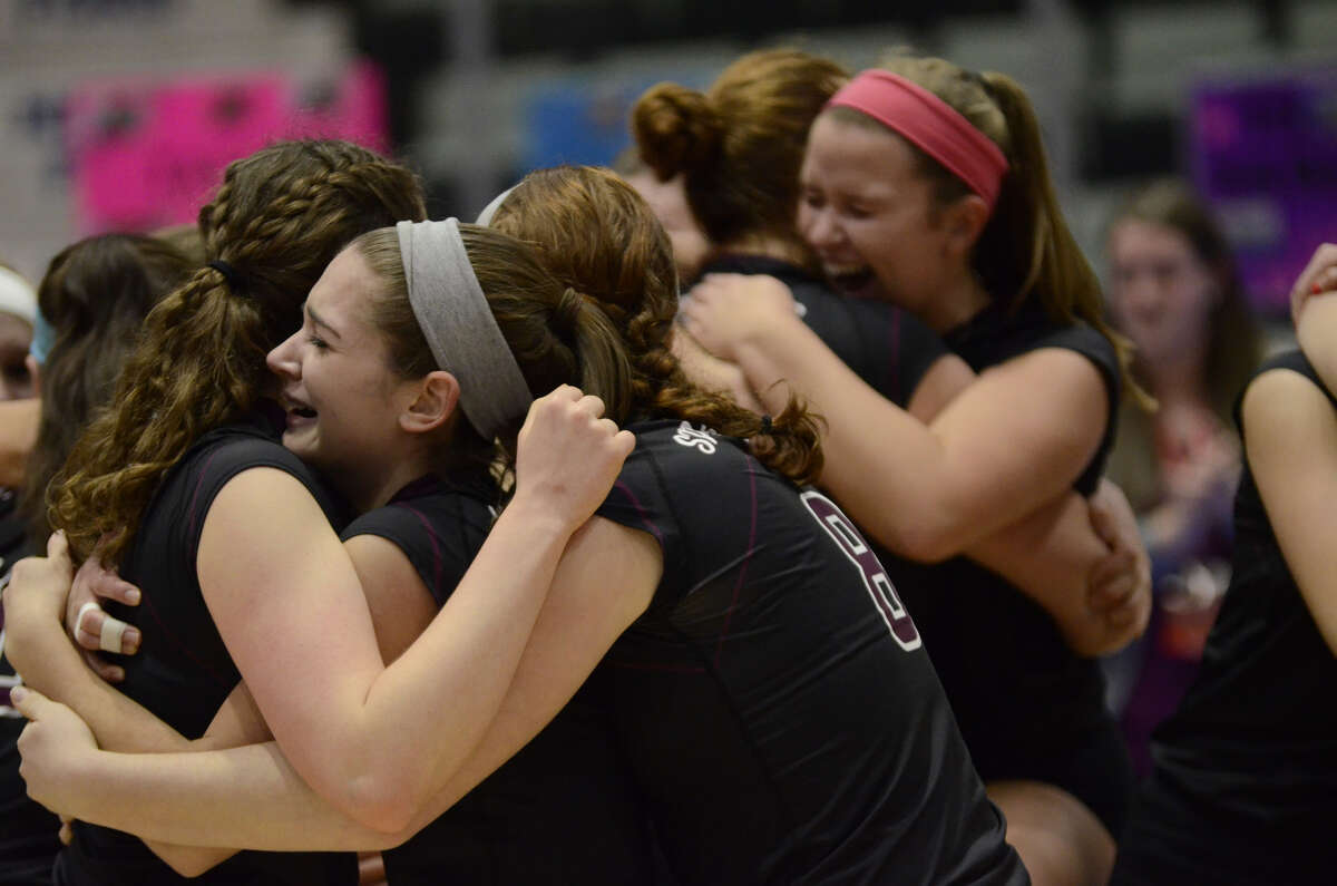 Burnt Hills-Ballston Lake volleyball players hug after winning the Class A State Volleyball Championship against Walter Panas, Sunday, Nov. 22, 2015, in Glens Falls, N.Y. (Jenn March/Special to the Times Union)
