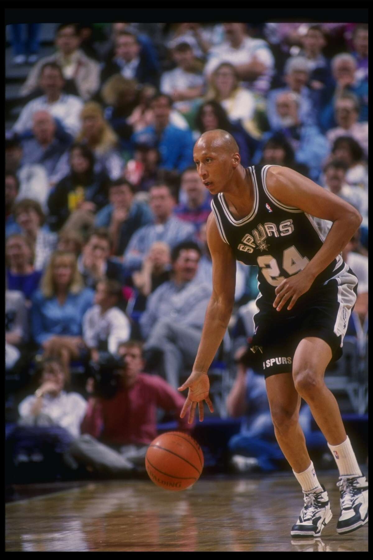 Guard Lloyd Daniels of the San Antonio Spurs moves the ball during a game against the Utah Jazz at the Delta Center in Salt Lake City, Utah