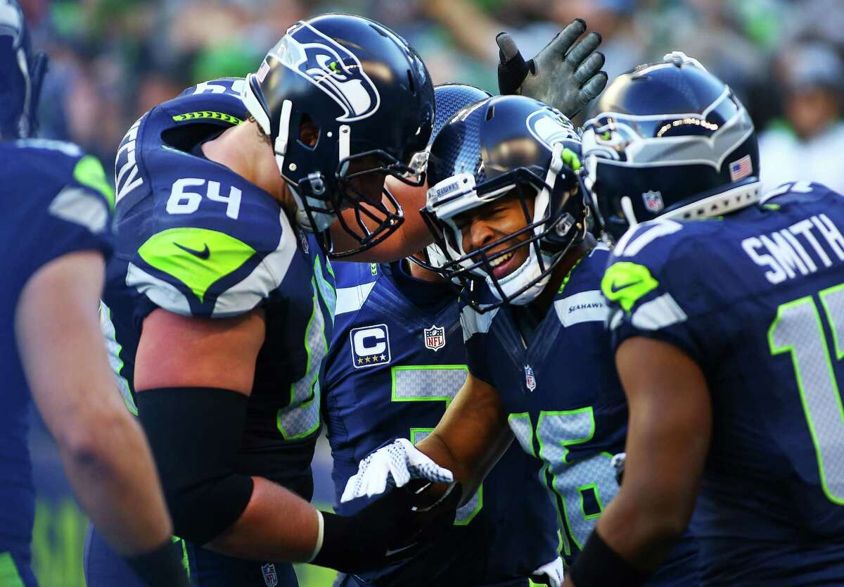 Teammates celebrate with Tyler Lockett (16) after he scored a touchdown in the first minutes of the Seahawks game against the 49ers, Sunday, Nov. 22, 2015.