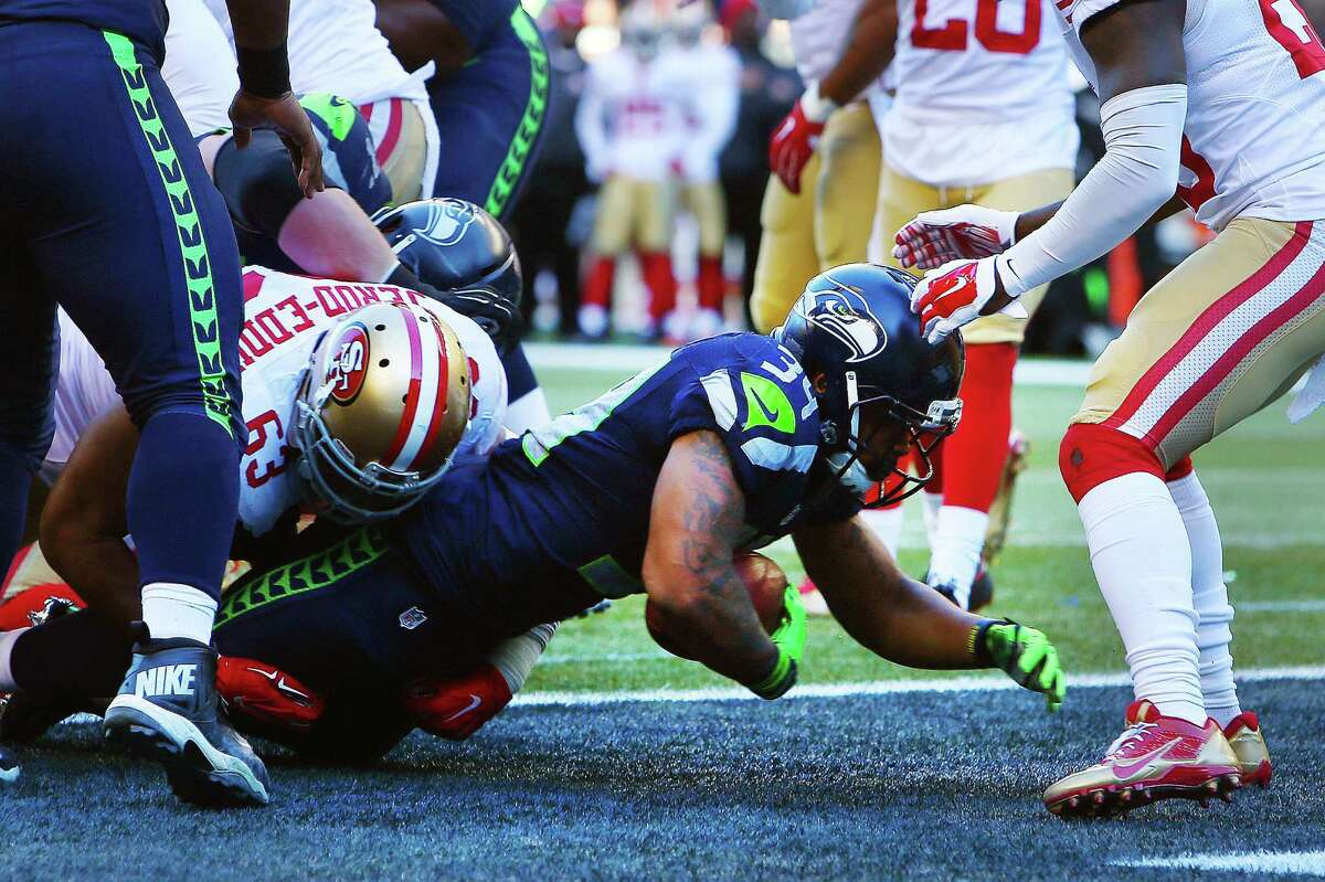 Seattle's Thomas Rawls (34) scores a touchdown in the first quarter of the Seahawks game against the 49ers, Sunday, Nov. 22, 2015 at CenturyLink Field.