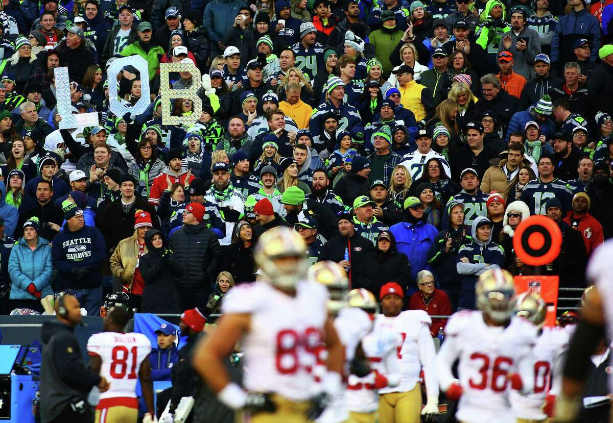 Fans hold up Legion of Boom letters in the stands during the fourth quarter of the Seahawks game against the 49ers, Sunday, Nov. 22, 2015. The Seahawks won 29-13.
