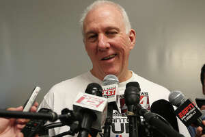 San Antonio Spurs head coach Gregg Popovich talks with media at the practice facility on June 17, 2014. The players were cleaning out their lockers after a winning season. They defeated the Miami Heat in the NBA Finals series, 4-1, to claim the championship..