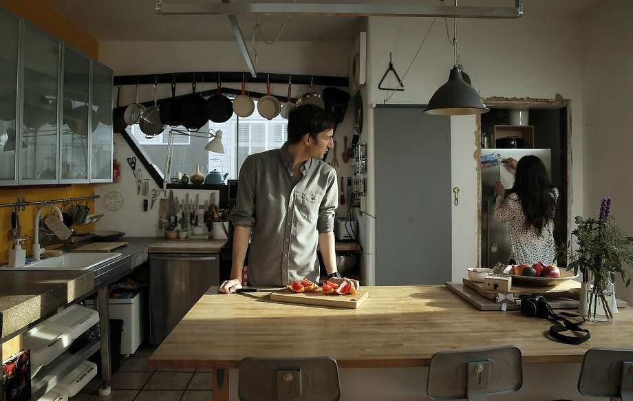 Aaron and Rachael Harvey in the kitchen of their SoMa flat in San Francisco. Photo: Carlos Avila Gonzalez, The Chronicle