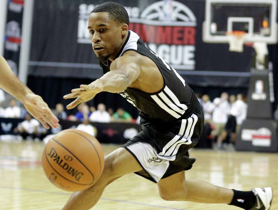 The Spurs' Bryce Cotton reaches for a loose ball during an NBA Summer League game against New Orleans on July 14, 2014, in Las Vegas. Photo: Isaac Brekken /For The Express-News / Express-News