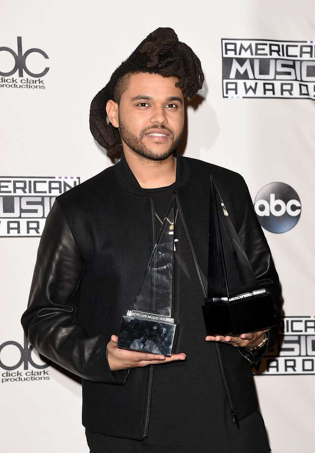 Recording artist The Weeknd, winner of Favorite Soul/R&B Male Artist and Favorite Soul/R&B Album, poses in the press room during the 2015 American Music Awards at Microsoft Theater on November 22, 2015 in Los Angeles, California.  (Photo by Jason Merritt/Getty Images) Photo: Jason Merritt, Getty Images