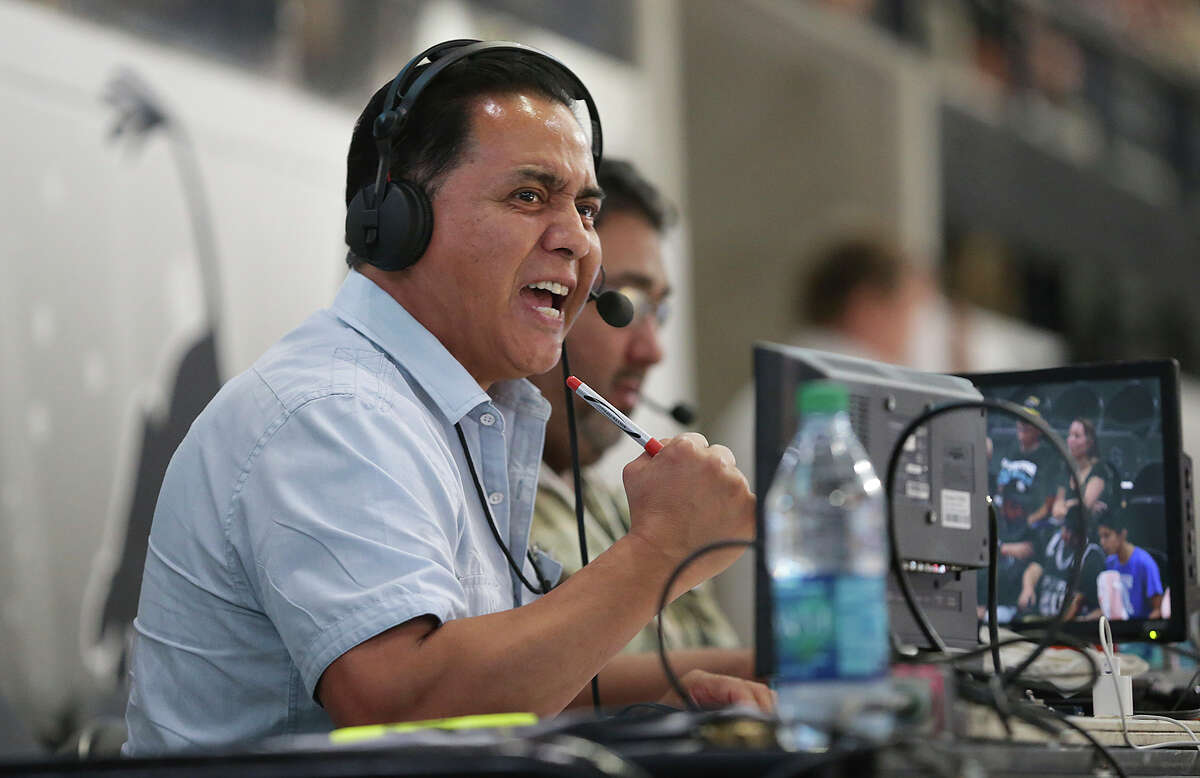 Spanish language broadcaster Paul Castro calls the game from his balcony level perch as the Spurs host the Phoenix Suns at the AT&T Center on Oct. 20, 2015.
