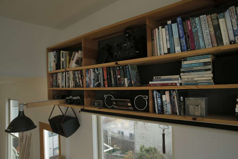 A bookshelf made by Aaron Harvey in the home he shares with his wife, Rachael, in San Francisco. Photo: Carlos Avila Gonzalez, The Chronicle