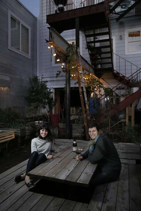 Rachael and Aaron Harvey on the deck in the backyard of their home in S.F. The couple transformed a top-floor flat into an urban oasis. Photo: Carlos Avila Gonzalez, The Chronicle