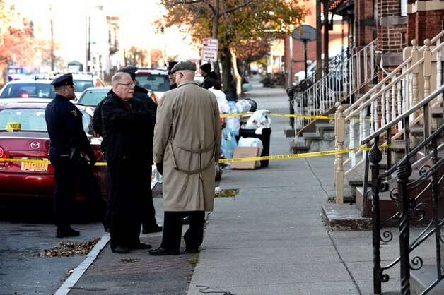 Rensselaer County District Attorney Joel Abelove, right, visits the scene of an early morning stabbing that left a woman in Troy dead and police searching for a 45-year-old man. (Skip Dickstein / Times Union)