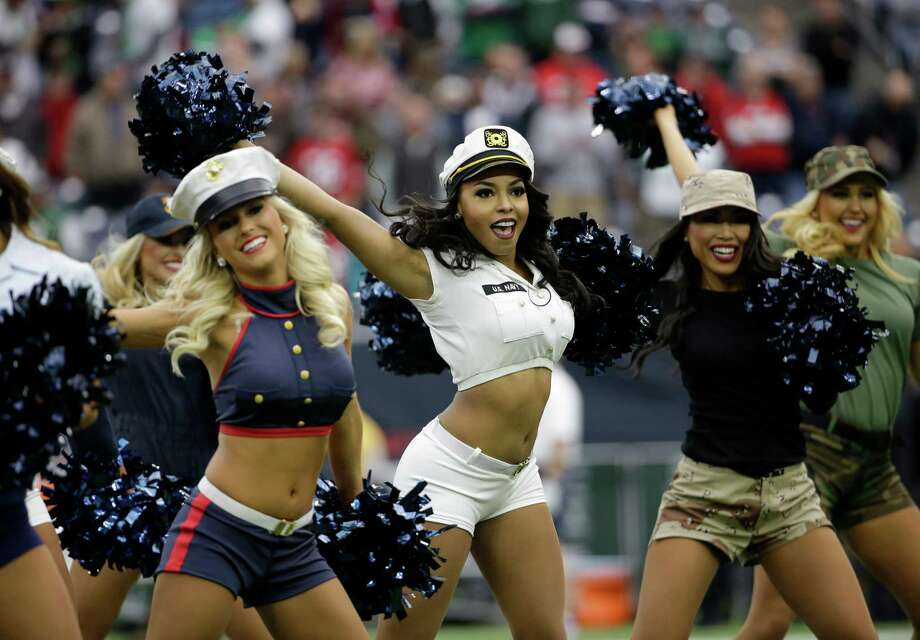 The Houston Texans cheerleaders wear military uniforms as a Salute to Service as they perform  prior to an NFL football game, Sunday, Nov. 22, 2015, in Houston. (AP Photo/David J. Phillip) Photo: David J. Phillip, Associated Press / AP