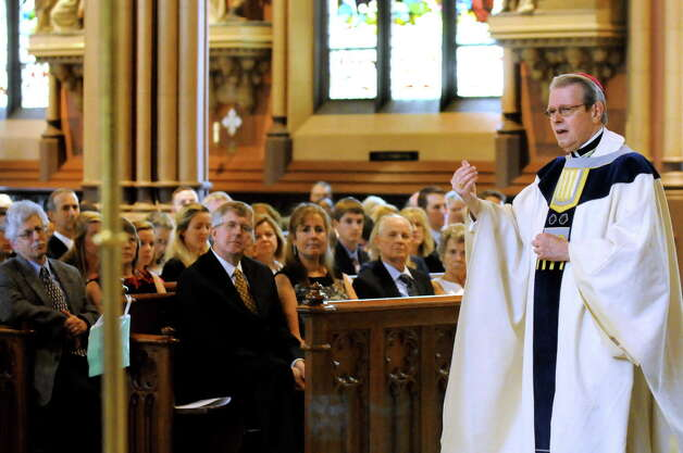 Bishop Edward Scharfenberger, right, speaks during the ordination of James Davis and Brian Slezak to the priesthood on Saturday, June 14, 2014, at the Cathedral of the Immaculate Conception in Albany, N.Y. (Cindy Schultz / Times Union) Photo: Cindy Schultz / 00027274A