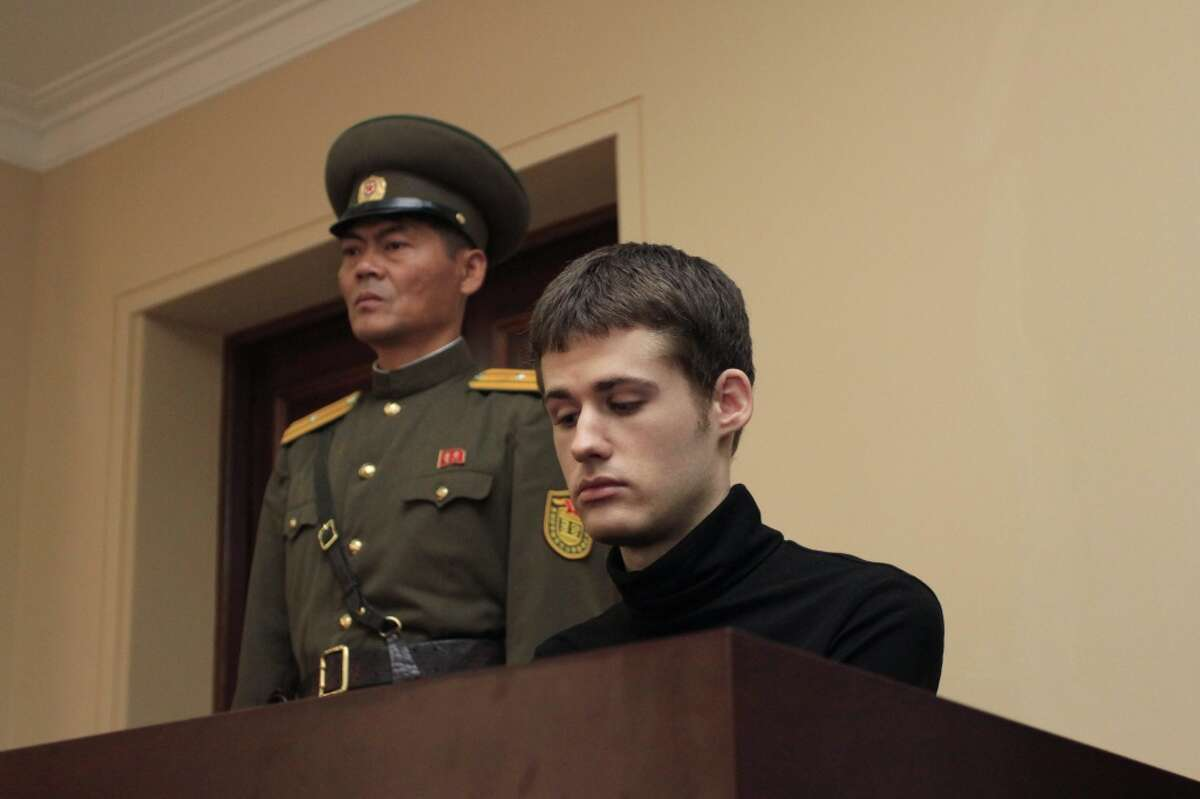Matthew Miller , a U.S. citizen, sits on the dock at the Supreme Court during his trial in Pyongyang, North Korea, Sunday, Sept. 14, 2014. North Korea's Supreme Court on Sunday sentenced Miller to six years of hard labor for entering the country illegally and trying to commit espionage. (AP Photo/Kim Kwang Hyon)
