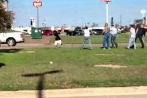 Video shows Texas woman firing gun at alleged Wal-Mart purse snatcher - Photo