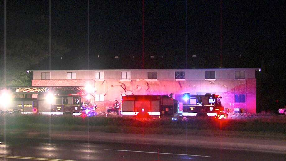 Two cars were damaged Sunday night when a brick wall collapsed at an apartment building on the Southeast Side. Photo: 21 Pro Video