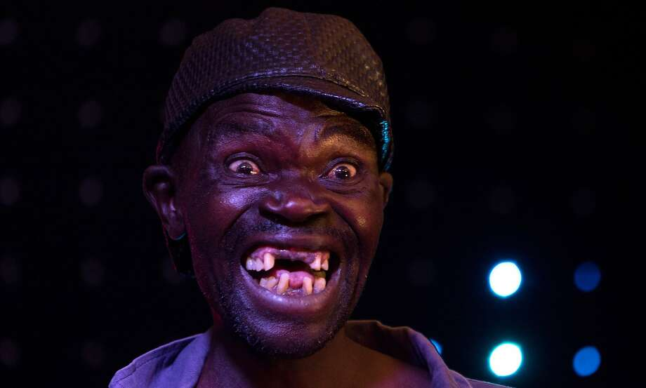 "Newly crowned ""Mr Ugly"" Zimbabwe, Mison Sere, poses during the ""Ugliest Man"" contest in Harare, Zimbabwe, on November 20, 2015. Photo: Jekesai Njikizana, AFP / Getty Images"