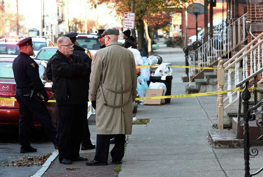 Troy Police and the Rensselaer County D.A. Joel Abelove investigate a murder at 3326 6th Avenue Nov. 23, 2015 in Troy, N.Y. (Skip Dickstein/Times Union)