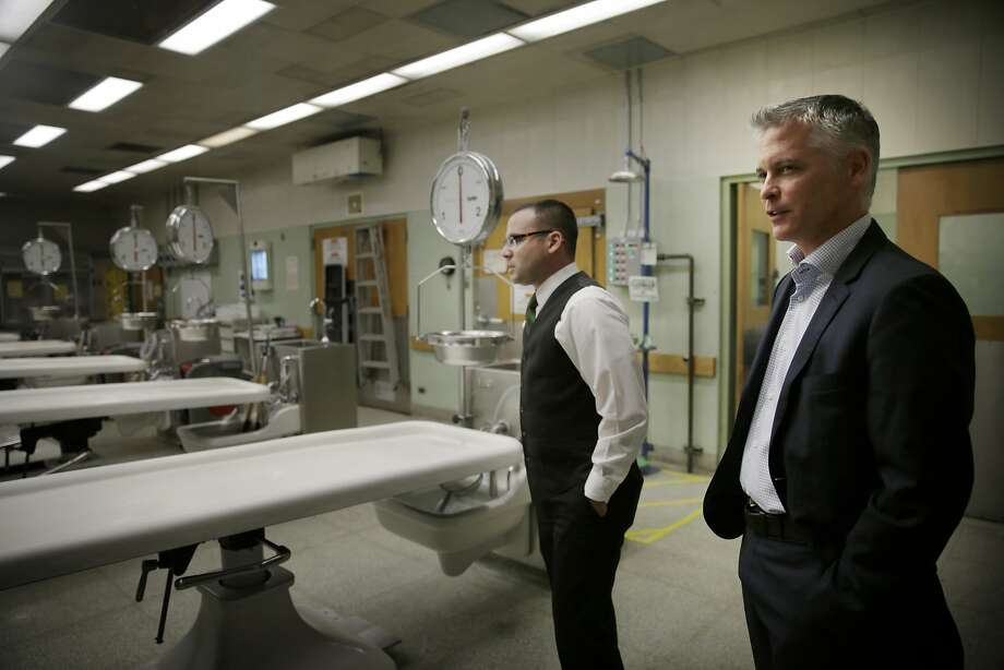 San Francisco Chief Medical Examiner Michael Hunter (right) and Christopher Wirowek (left), deputy director Medical Examiner's Office, talk as they stand in the autopsy suite during a tour at the Hall of Justice  on Wednesday, November 18,  2015 in San Francisco, Calif. Photo: Lea Suzuki, The Chronicle