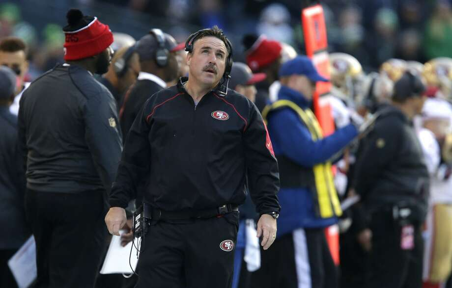 San Francisco 49ers head coach Jim Tomsula looks to the scoreboard in the first half of an NFL football game against the Seattle Seahawks, Sunday, Nov. 22, 2015, in Seattle. (AP Photo/John Froschauer) Photo: John Froschauer, Associated Press