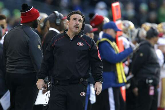 San Francisco 49ers head coach Jim Tomsula looks to the scoreboard in the first half of an NFL football game against the Seattle Seahawks, Sunday, Nov. 22, 2015, in Seattle. (AP Photo/John Froschauer)
