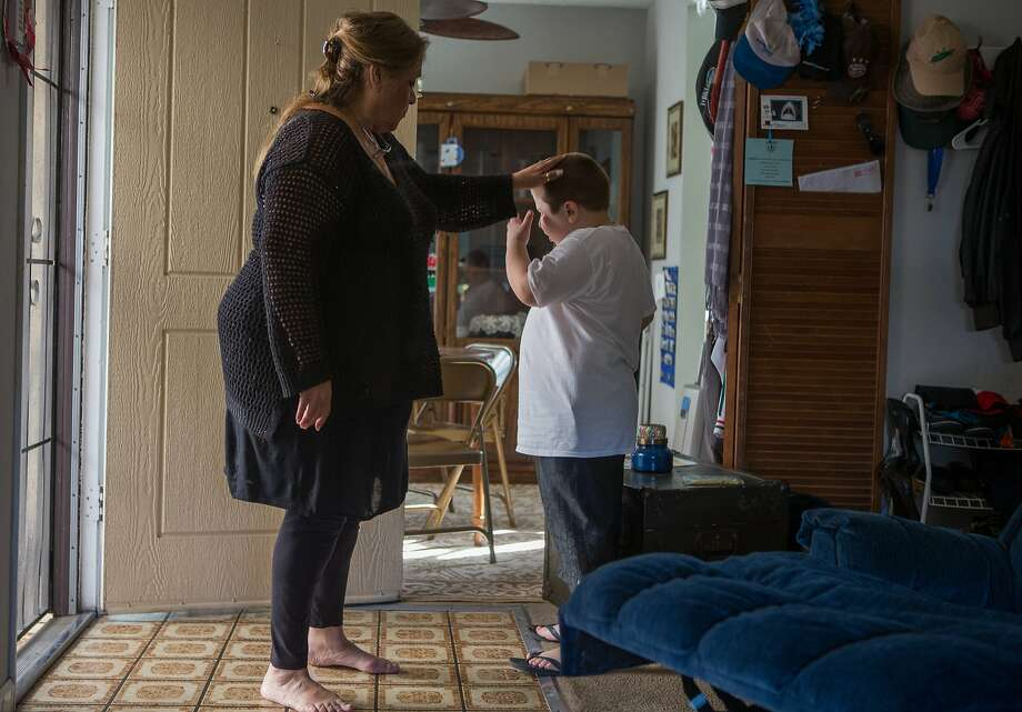 Beatrice Shaw reassures her great grandson, Anthony, 7 on Friday, Nov. 20, 2015 in Hayward, Calif. Photo: Nathaniel Y. Downes, The Chronicle