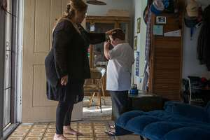 Woman raising 2 autistic great-grandsons gets help with rent, bills - Photo