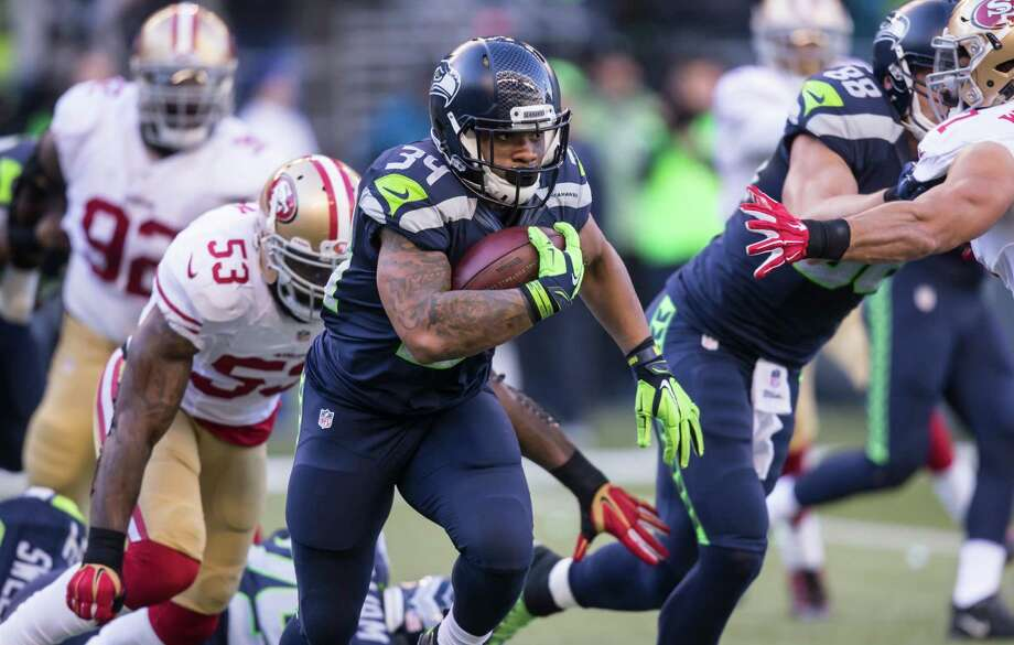 Running back Thomas Rawls of the Seattle Seahawks runs with the ball during the first half of a game against the San Francisco 49ers at CenturyLink Field on November 22, 2015 in Seattle, Washington. The Seahawks won the game 29-13. Photo: Stephen Brashear, Getty Images / 2015 Getty Images