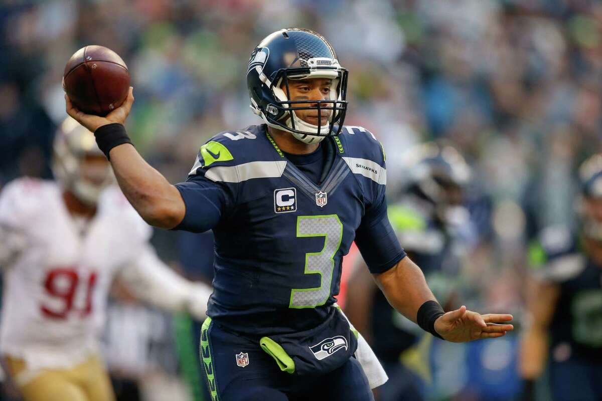 Quarterback: Russell Wilson was as efficient as he's been all season, completing 24 of 29 pass attempts to eight different receivers for 260 yards and three touchdowns. Wilson also used his legs effectively, rushing eight times for 30 yards. Sure, he missed on a deep ball and perhaps bailed out of the pocket a little quicker than necessary on occasion, but he deserves high marks for his best effort of the 2015 campaign. Grade: A