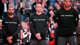 San Antonio Spurs' Tony Parker (from left), Manu Ginobili, and Tim Duncan stand during the national anthem before the game with the Memphis Grizzlies Saturday Nov. 21, 2015 at the AT&T Center.