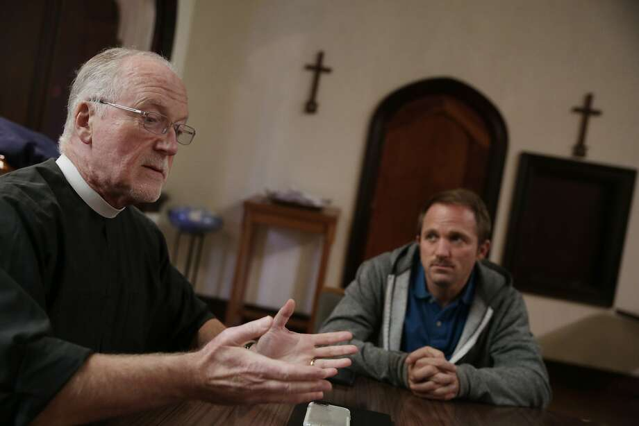 Parishioner Michael Mallory (right), listens as Father Richard Smith (left), Vicar, answers a question during an interview at The Episcopal Church of St. John the Evangelist on Monday, November 23,  2015 in San Francisco, Calif. Photo: Lea Suzuki, The Chronicle