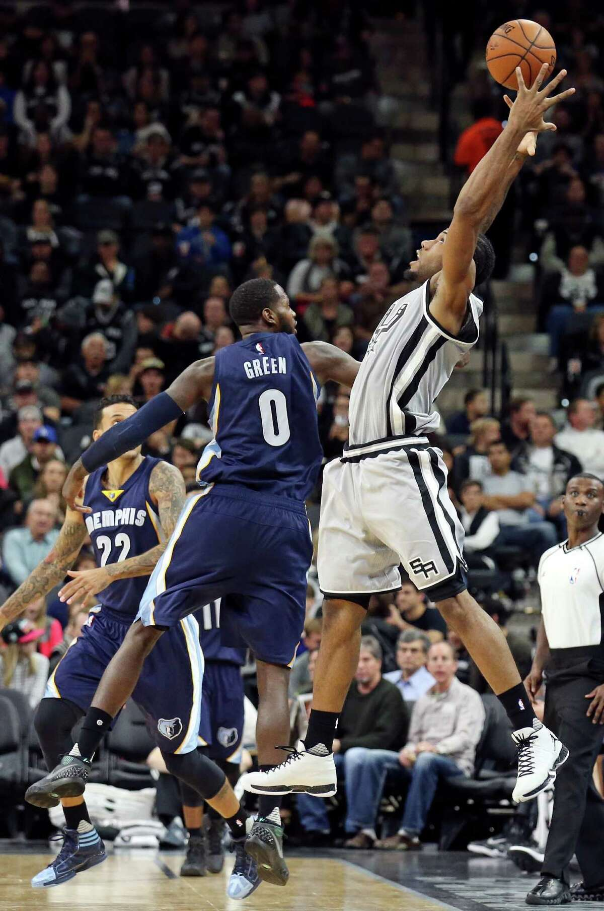San Antonio Spurs' Kawhi Leonard grabs for a loose ball against Memphis Grizzlies' JaMychal Green during second half action Saturday Nov. 21, 2015 at the AT&T Center. The Spurs won 92-82.
