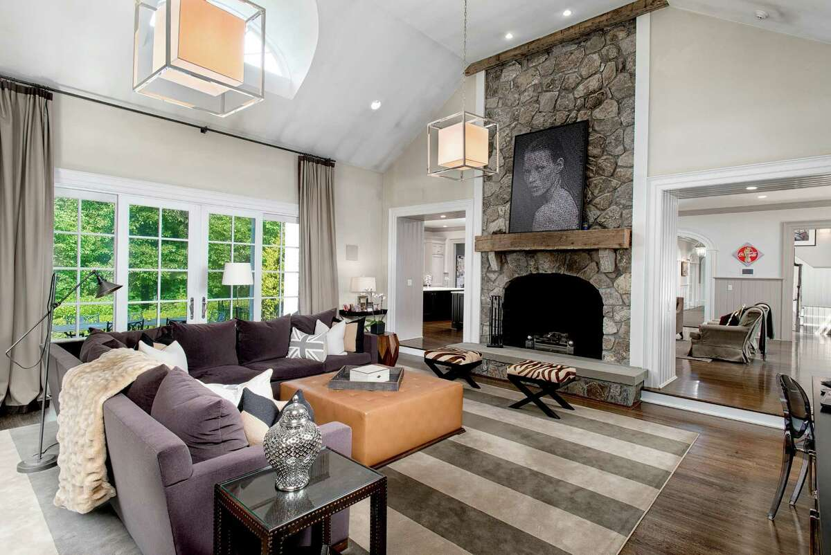 The family room includes a floor-to-ceiling stone fireplace.