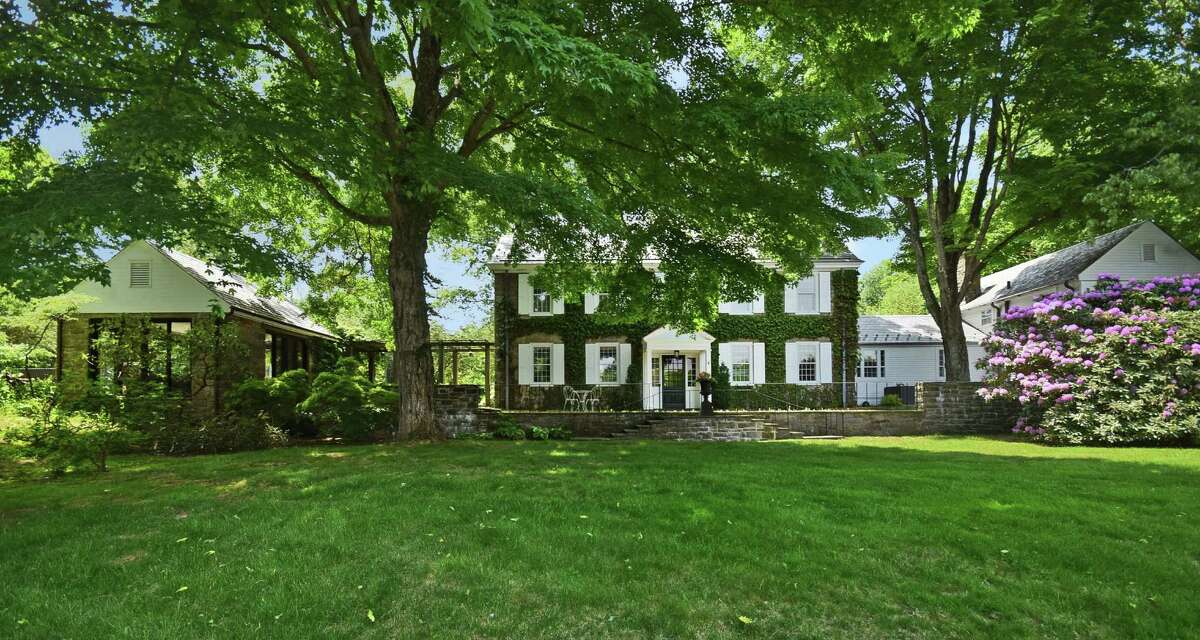 This 1937 home on Thrush Lane in New Canaan rests atop a hill on a 3.3-acre property.