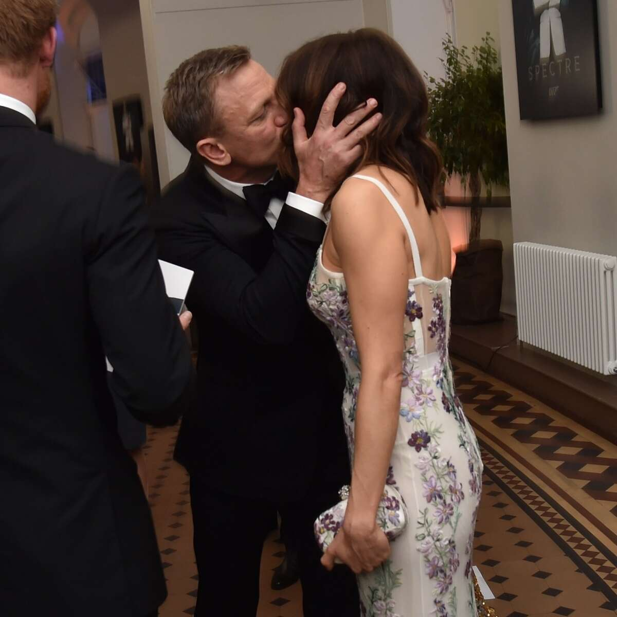 """Daniel Craig kisses his wife actress Rachel Weisz while they attend The Cinema and Television Benevolent Fund's Royal Film Performance 2015 of the 24th James Bond Adventure, """"Spectre"""" at Royal Albert Hall on Oct. 26, 2015 in London, England."""