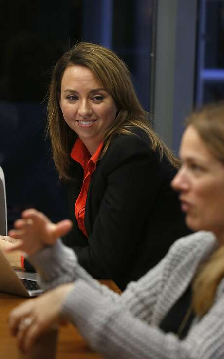 VP of product marketing Jamie Domenici (background) listens to SVP of product marketing sales cloud Sara Varni during a gathering at a Salesforce conference room in San Francisco, California, on Monday, November 23, 2015. Photo: Liz Hafalia, The Chronicle