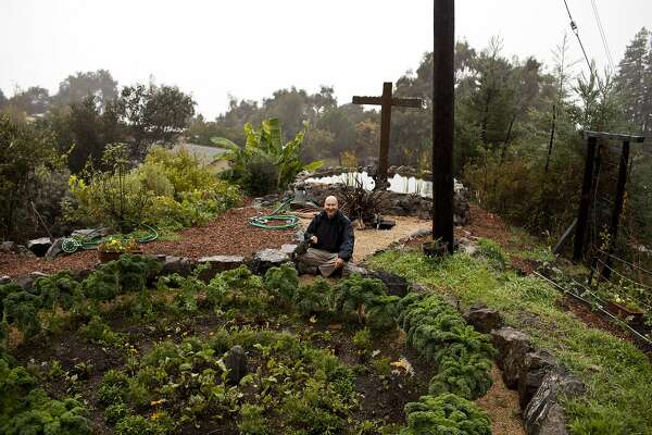 Michael Devadattan Faryan, master gardener of New Camaldoli Hermitage Monastery,  tends to the garden where he grows fruits and vegetables in the rain in Big Sur, Calif., Saturday, November 17, 2012. The monks make money by selling the granola, which they make on-site, and holiday fruit cakes, which are now made off-site in Seaside, Calif.