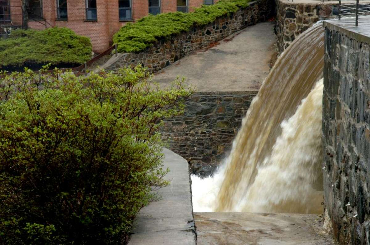 The dam of the Byram River, at the Mill, at Glenville was roaring during the rain storm on Tuesday, March 30, 2010.