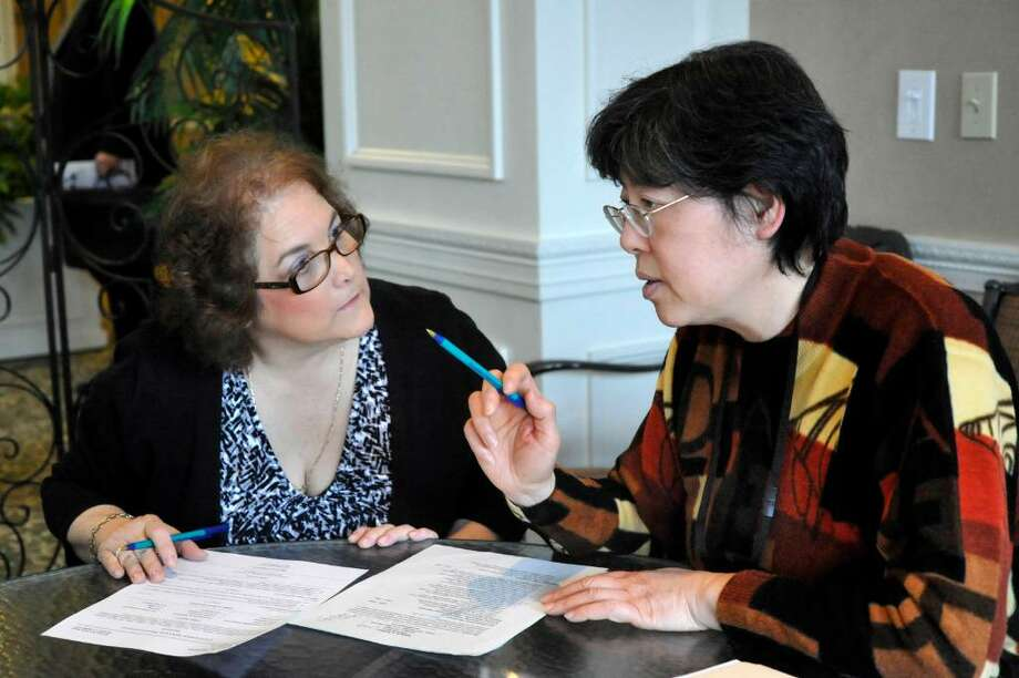 Michele DeMici of Danbury, left, gets advice from Xuefei Zhang, certified professional resume writer with the Department of Labor, at the Danbury Career Fair held at Ethan Allen Hotel on Tuesday, March 30, 2010. Photo: Michael Duffy / The News-Times