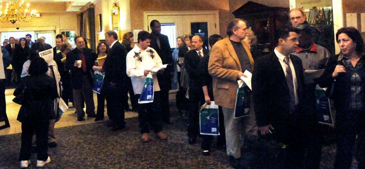 Job seekers wait in a line that streched through the lobby and down a hallway at the Danbury Career Fair held at Ethan Allen Hotel on Tuesday, March 30, 2010.