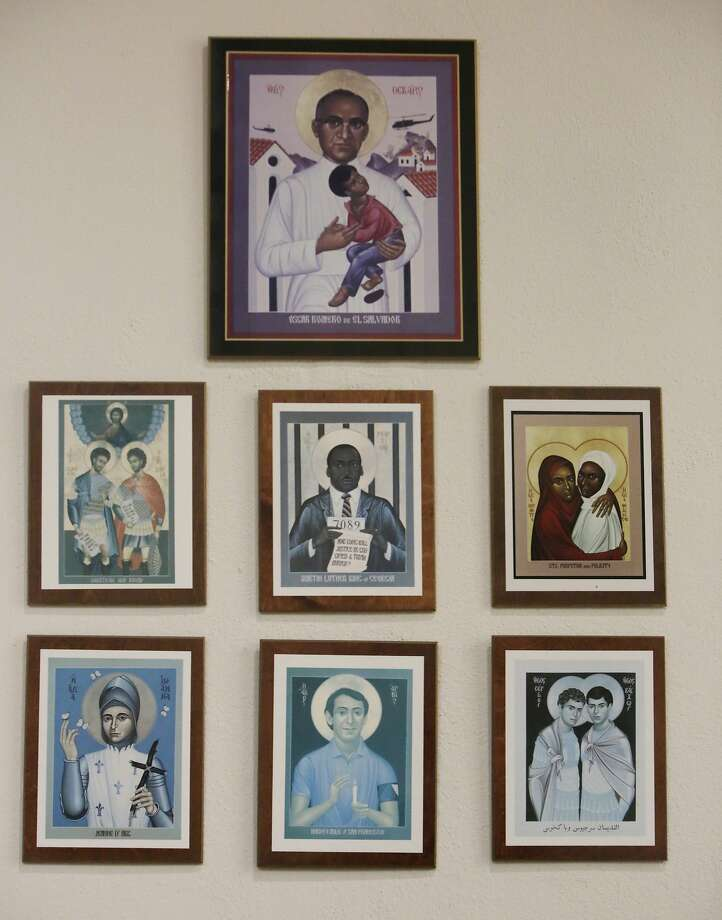A portrait of people that  The Episcopal Church of St. John the Evangelist  considers Saints including Oscar Romero (top), Martin Luther King (center) and Harvey Milk (bottom center), are seen on the wall in the Nave at The Episcopal Church of St. John the Evangelist on Monday, November 23,  2015 in San Francisco, Calif. Photo: Lea Suzuki, The Chronicle